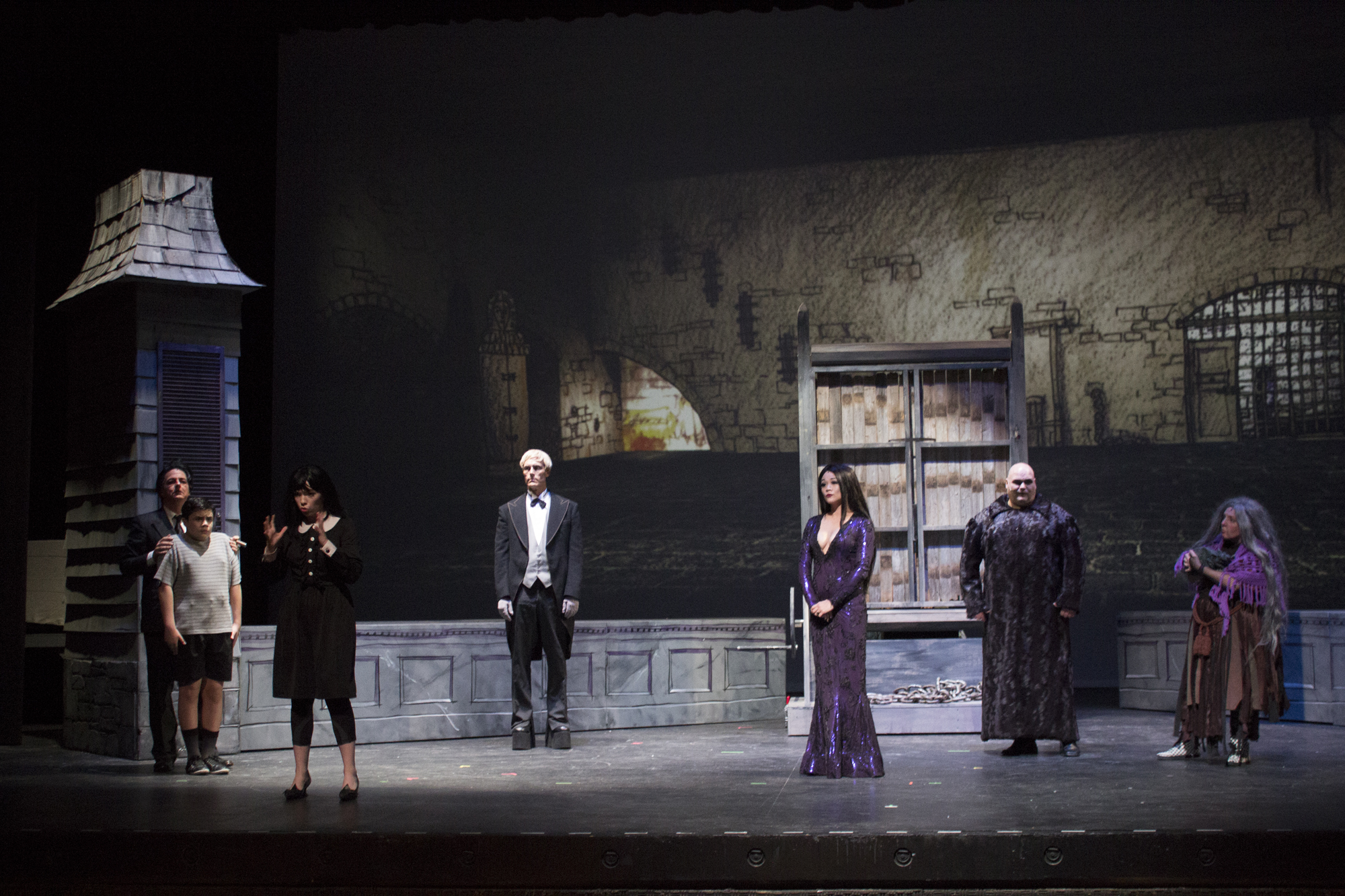 MILC_The Addams Family_L-R_Michael Robinson as Gomez_Javier Casanova Jr. as Pugsley_Caroline Ellis as Wednesday_Russell Batchelor as Lurch_Olivia de Guzman Emile as Morticia_Stephen Bates as Fester_Megan Kelly-Bates as Grandma_Photo by Travis J. Fant
